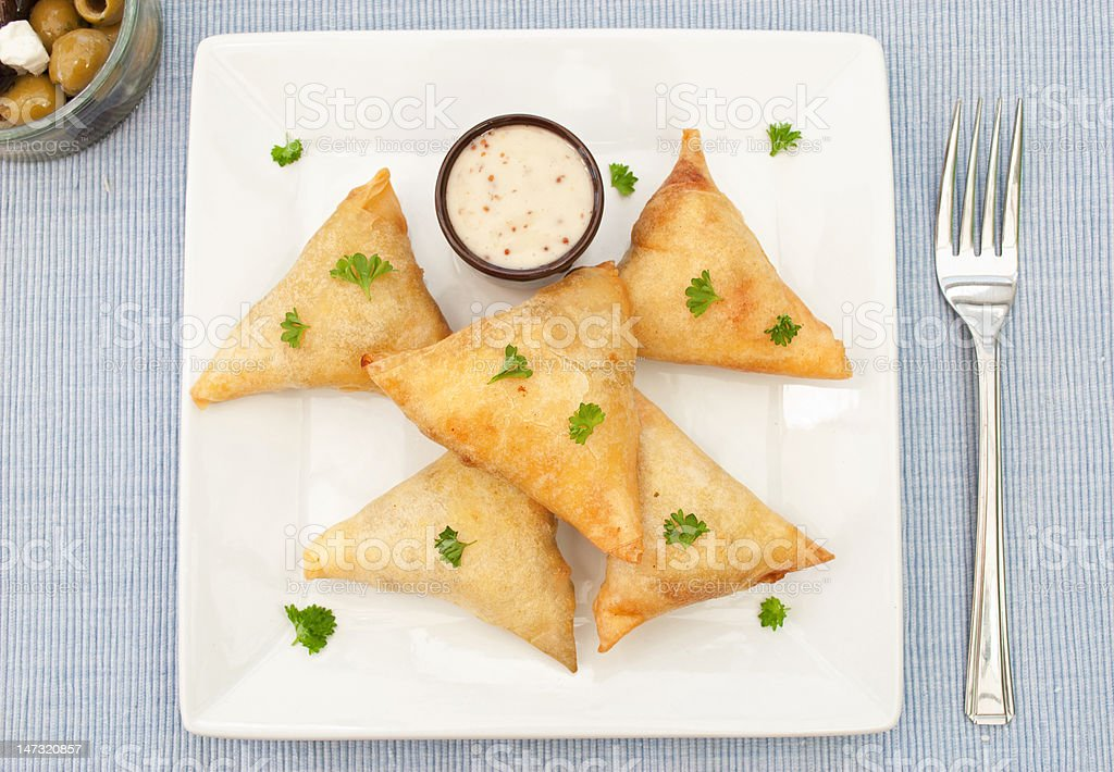 Feta and spinach triangles stock photo