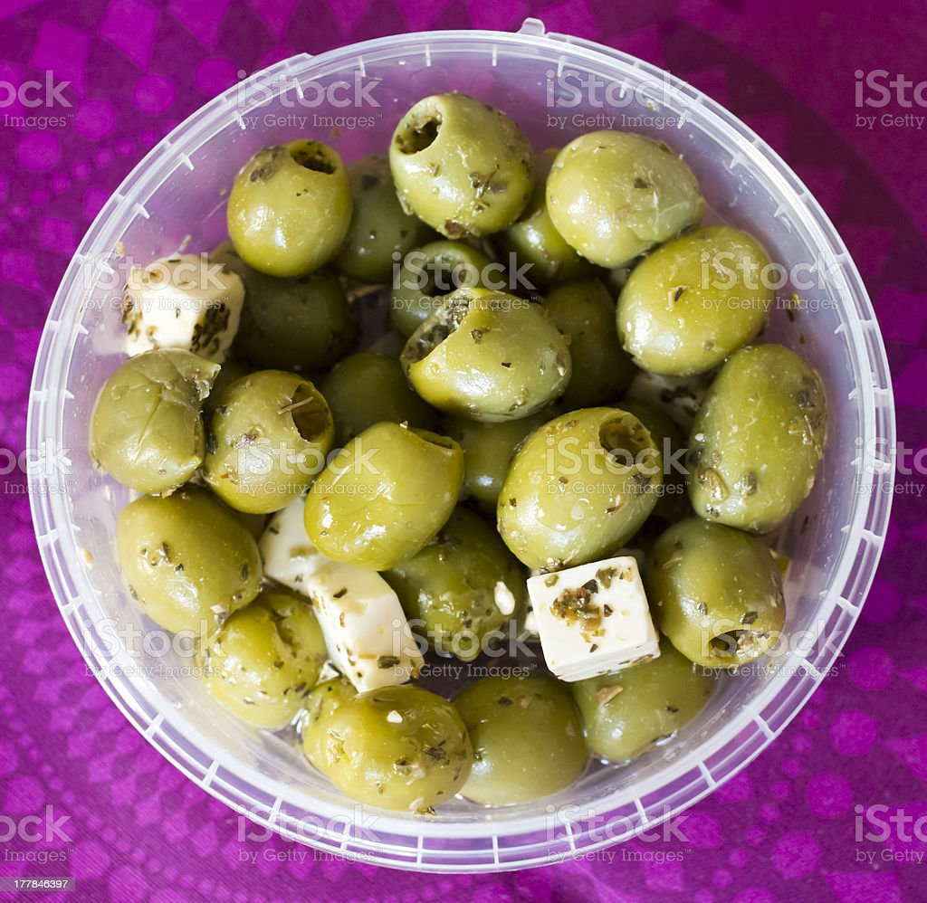 feta cheese and olives with herbs in olive oil royalty-free stock photo