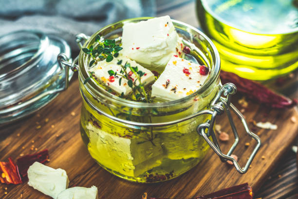 Feta cheese marinated in olive oil with spices stock photo