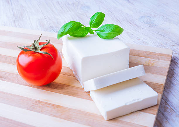 feta cheese on the kitchen board stock photo