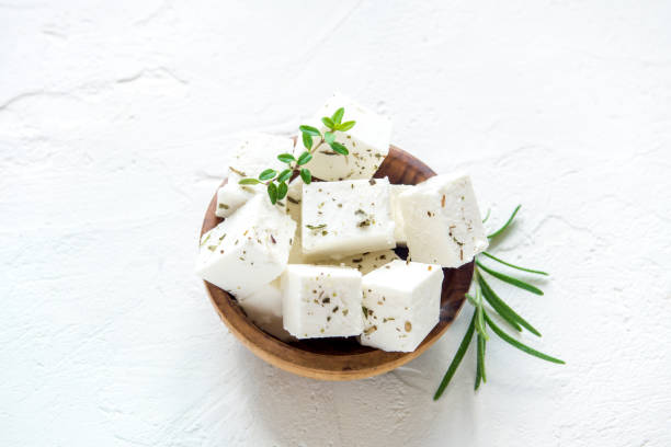 Feta Cheese Fresh Greek Feta Cheese. Healthy ingredient for cooking salad. Chopped Goat feta cheese with herbs. feta cheese stock pictures, royalty-free photos & images