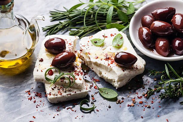 Feta cheese with olives stock photo