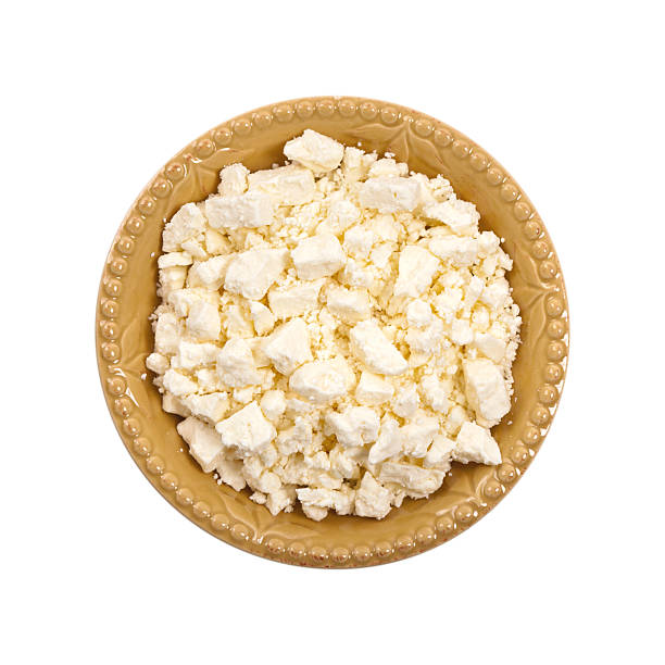 Feta Crumbled Cheese Feta Crumbled Cheese Isolated on White. Selective focus. feta cheese stock pictures, royalty-free photos & images