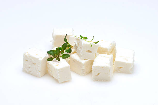feta cubes feta cheese cubes and oregano on a white background feta cheese stock pictures, royalty-free photos & images