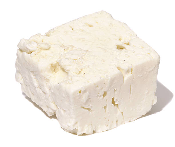 Feta Feta cheese on a white background with a shadow feta cheese stock pictures, royalty-free photos & images