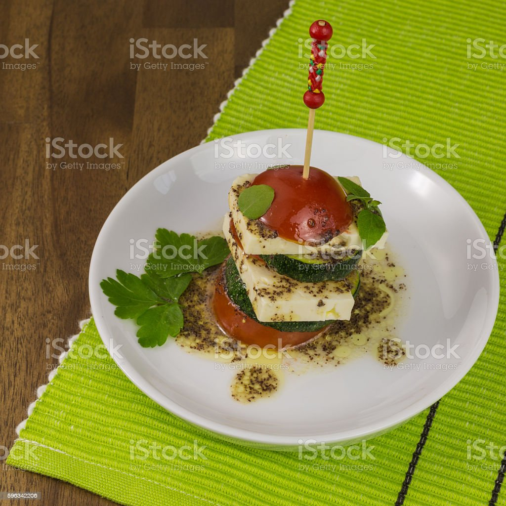 feta slices with tomato and zucchini royalty-free stock photo