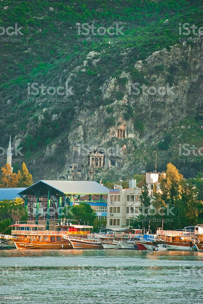 Fethiye harbour and ruins from the water, Turkey stock photo
