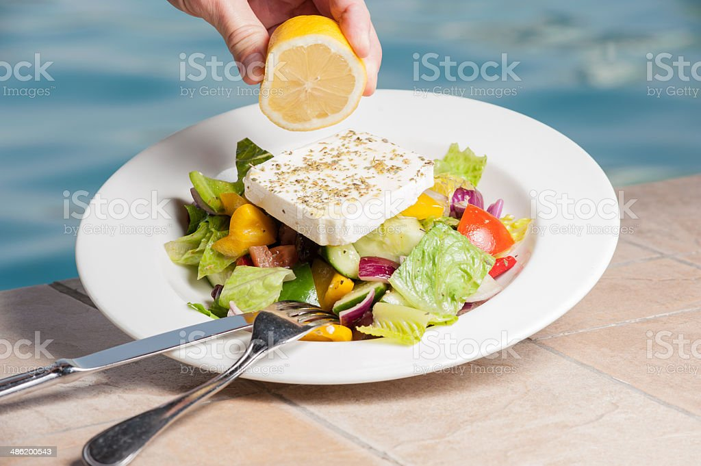 Fetta cheese salad with lemon stock photo