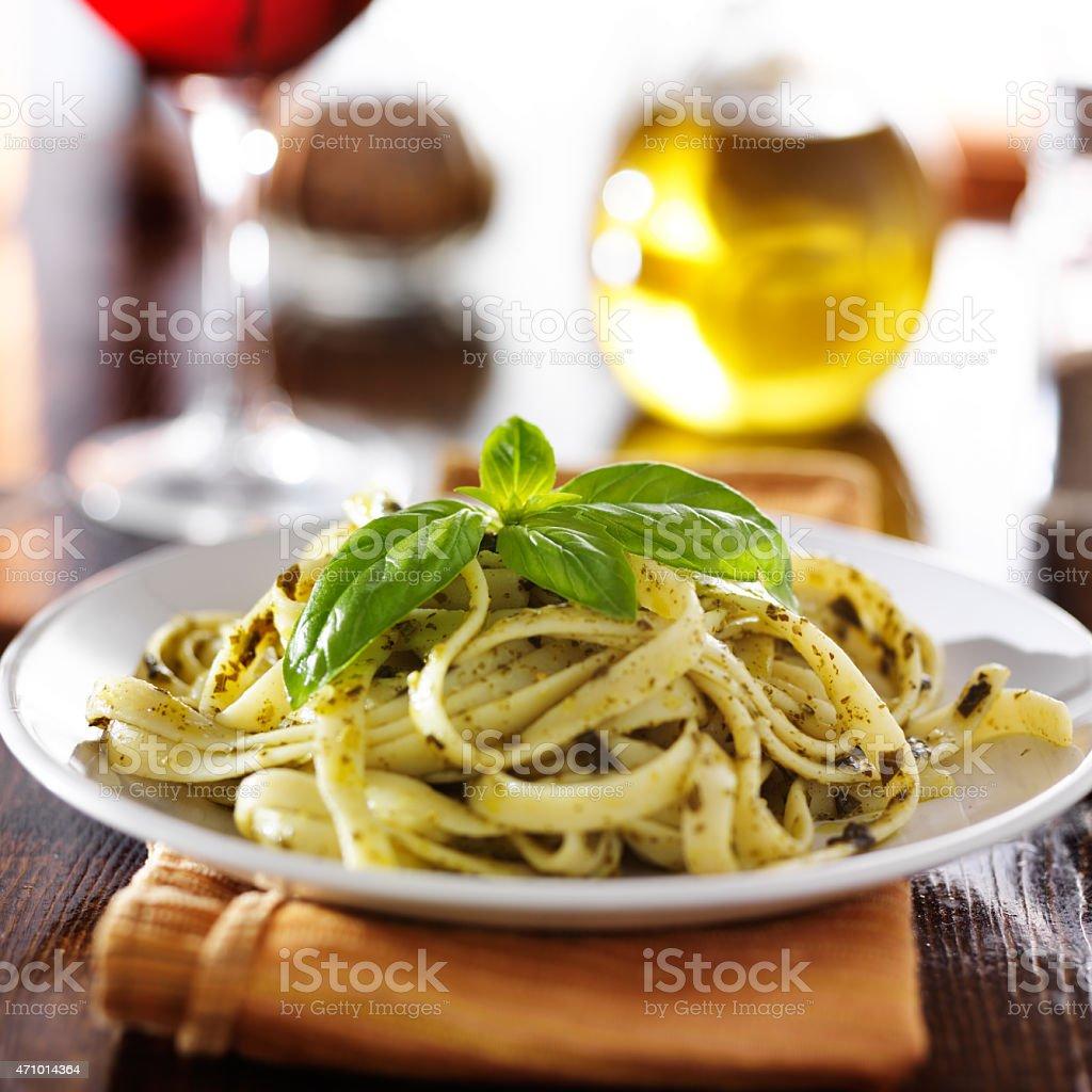 fettuccine in basil pesto sauce stock photo