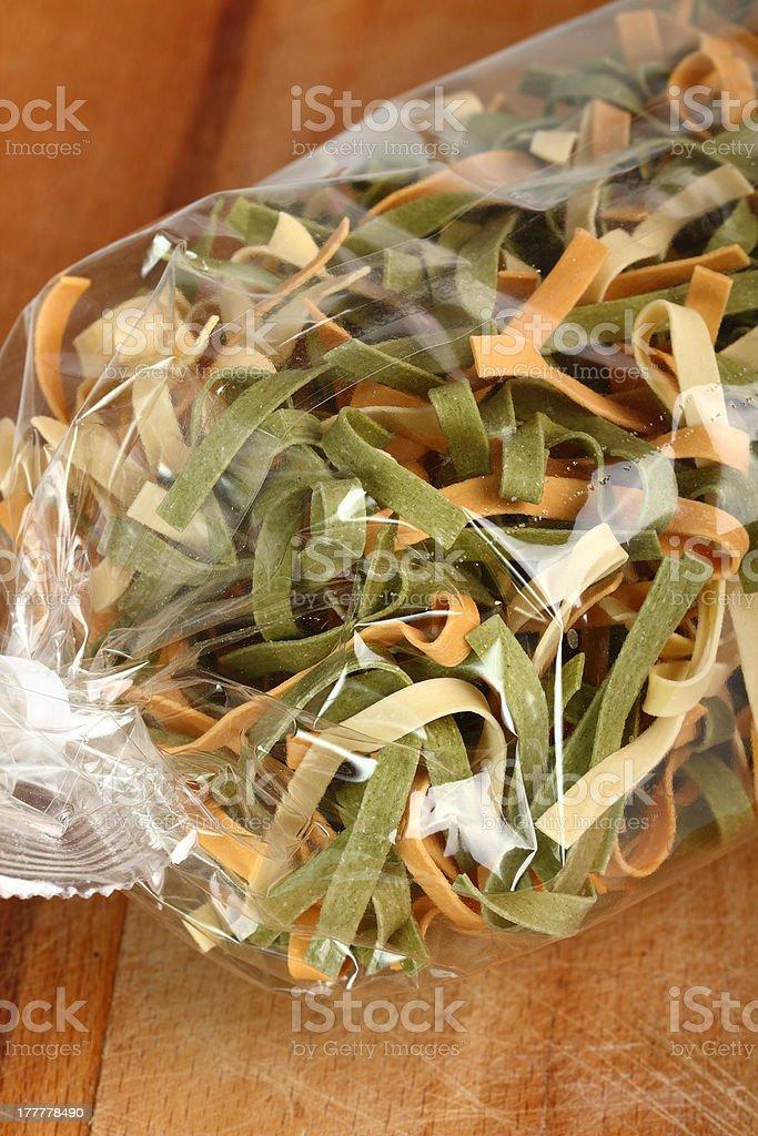 Fettuccine in plastic bag royalty-free stock photo