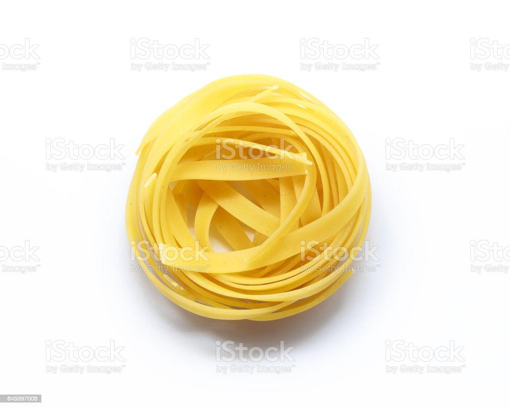 Fettuccine italian pasta isolated on white background stock photo