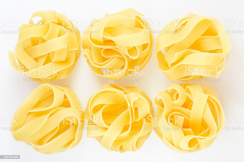 Fettuccine on a white background royalty-free stock photo