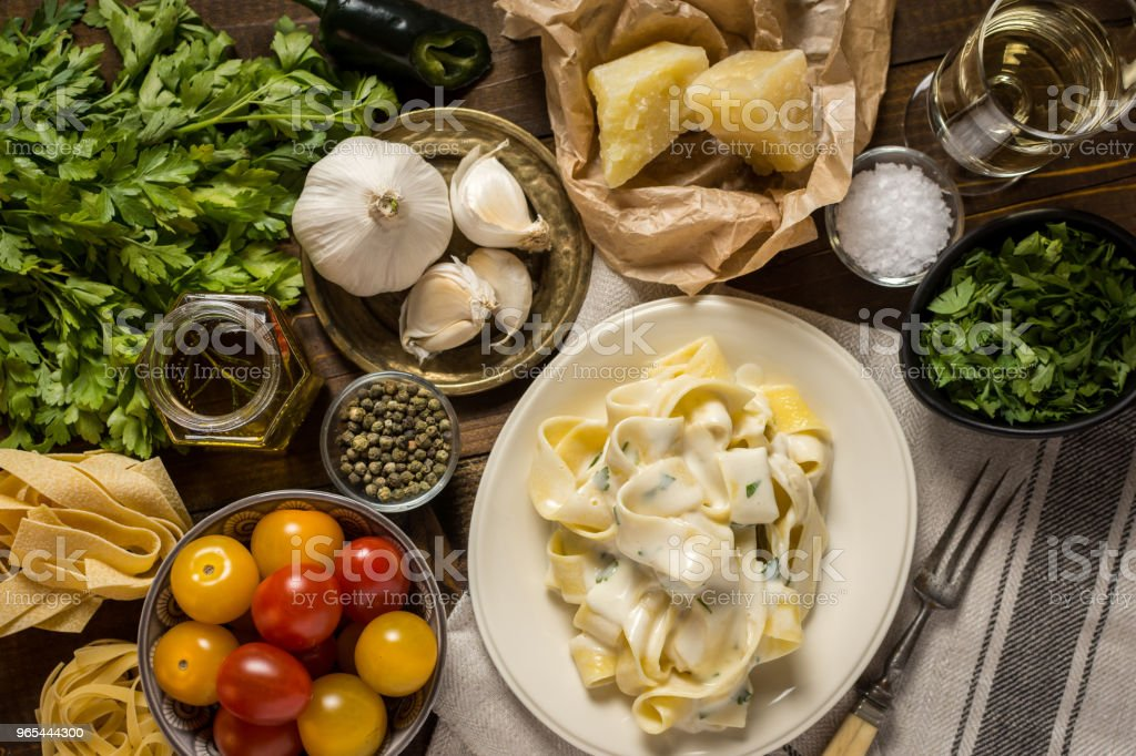 Fettuccine Pasta Plate with Creamy Alfredo Sauce royalty-free stock photo