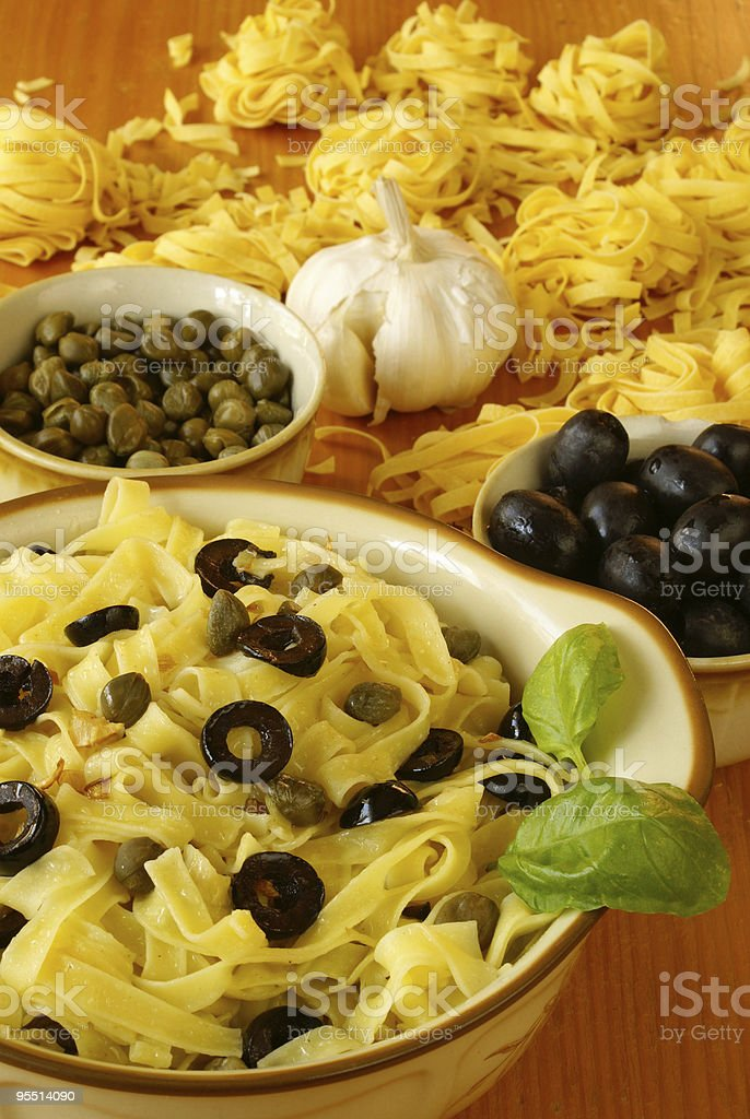 Fettuccine with olives and capers royalty-free stock photo