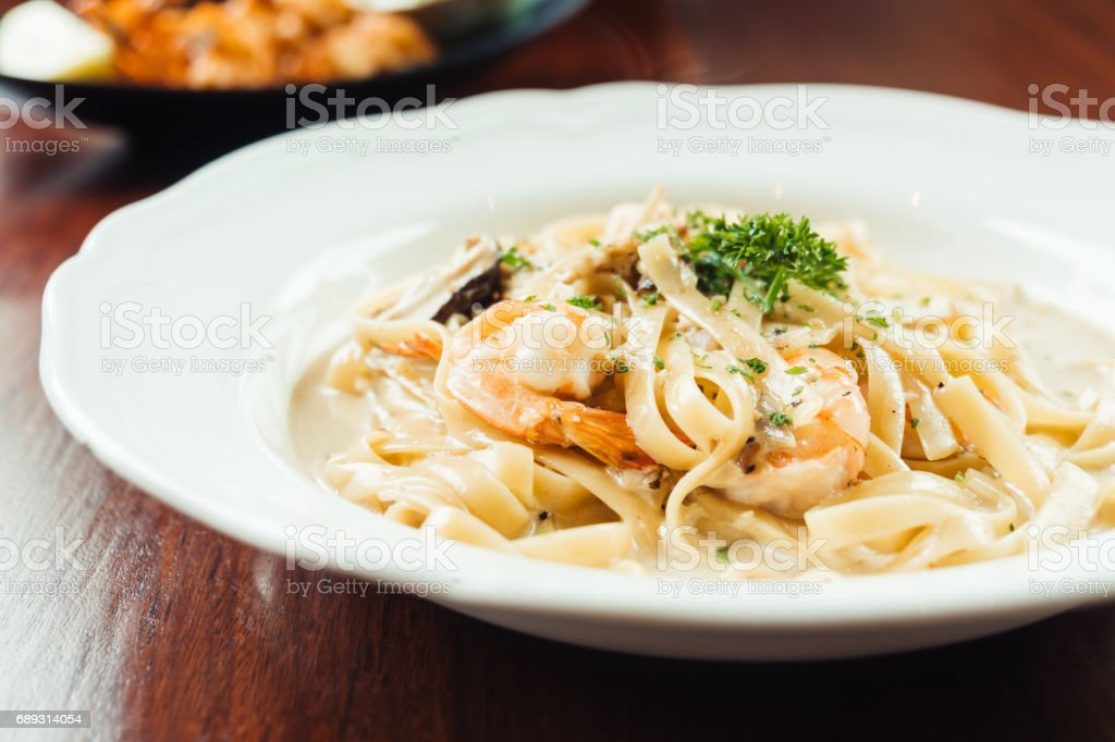 fettucine white cream sauce with shrimp and mushroom stock photo