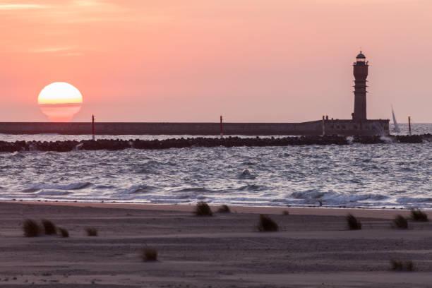 Feu de Saint-Pol lighthouse in Dunkirk at sunset Feu de Saint-Pol lighthouse in Dunkirk at sunset.  Dunkirk, Hauts-de-France, France. feu stock pictures, royalty-free photos & images