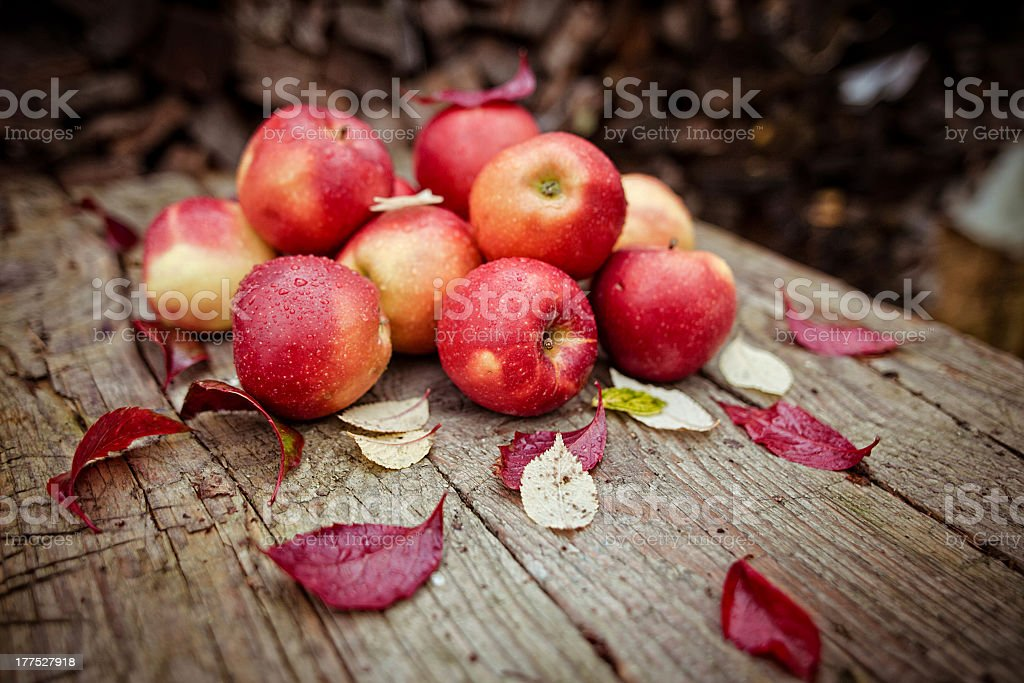 Few apples in the village on a wooden table royalty-free stock photo