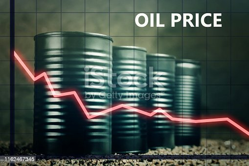 Few barrels of oil and a red graph down - decline in oil prices concept.