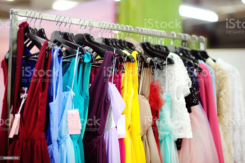 A few beautiful wedding dresses on a hanger. stock photo