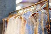 istock A few beautiful wedding dresses on a hanger. 658662436