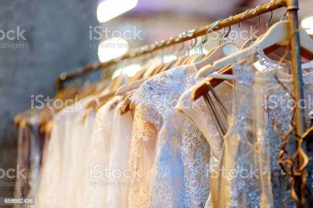Few beautiful wedding dresses on a hanger picture id658662436?b=1&k=6&m=658662436&s=612x612&h=vbgw whex1zl mgz2cm6hny64qruixq9u2p1trtob3m=