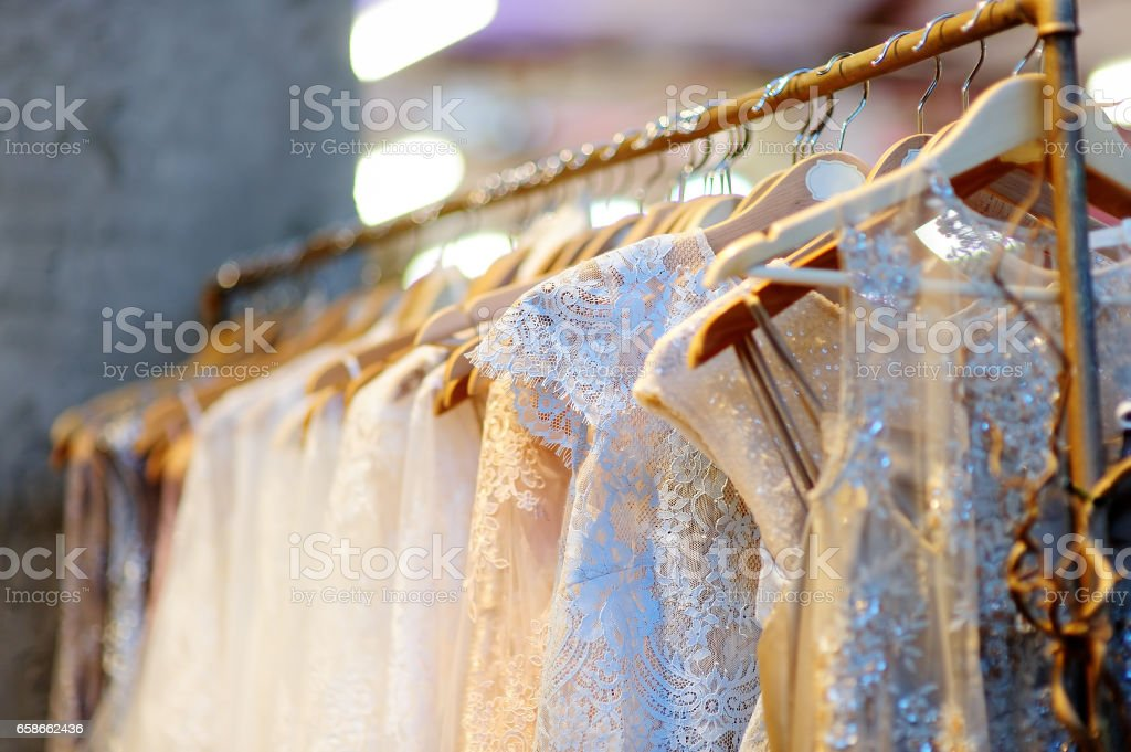 A few beautiful wedding dresses on a hanger. stock photo