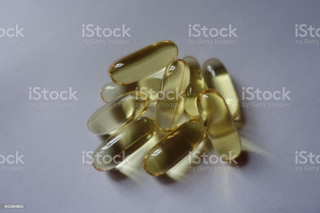Few big softgel capsules of fish oil stock photo