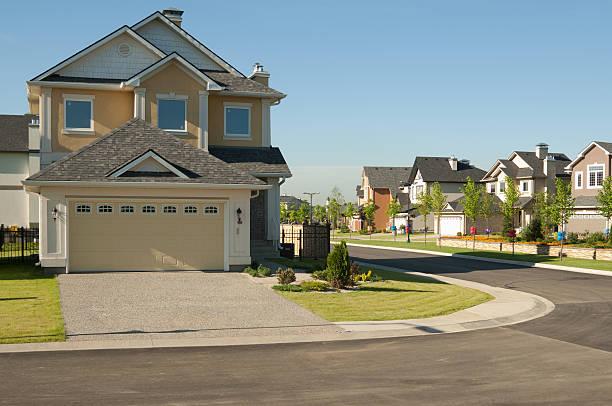few brand new suburban houses. - suburban street stock photos and pictures