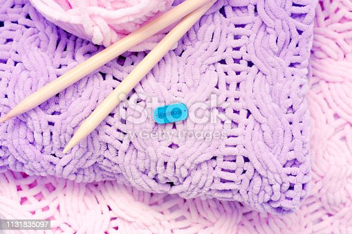 A few bright colored knitting needles bedspreads or blankets. Comfort, homely warmth. Selective focus