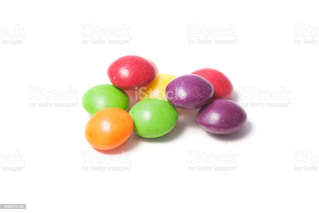 Few colorful small rounded candies stock photo