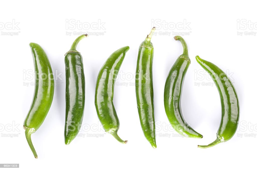 Few green hot peppers on white background stock photo