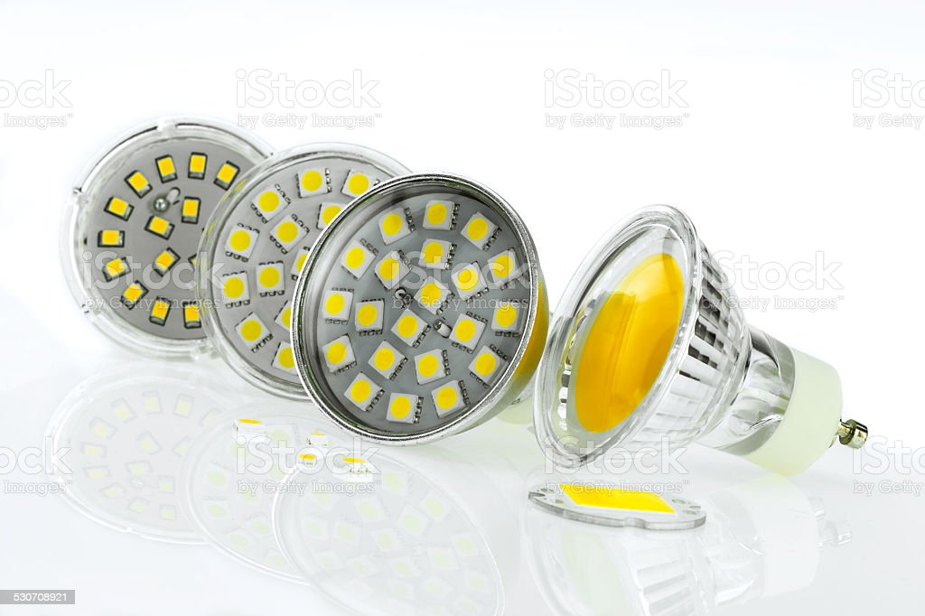 few GU10 LED bulbs with different sizes chips stock photo