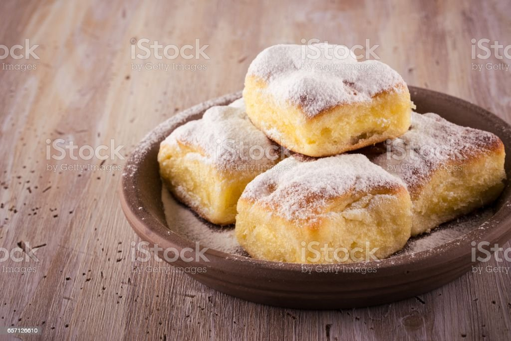Few Homemade traditional cakes filled by curd on wooden board stock photo