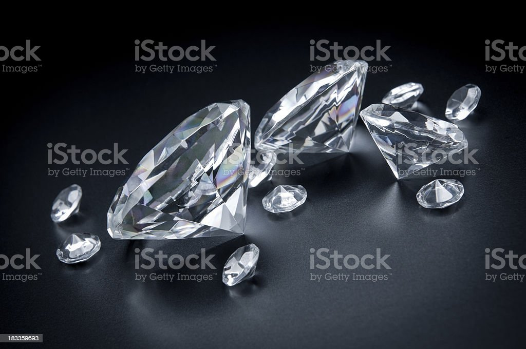 Few, huge diamonds scattered on black background royalty-free stock photo