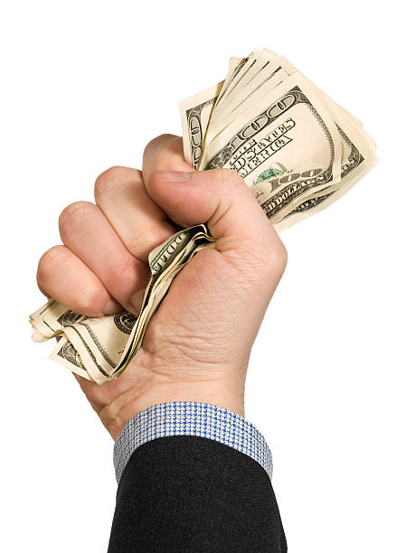 Few hundred A few one hundred dollar bills on a man's fist. Isolated on white. handful stock pictures, royalty-free photos & images