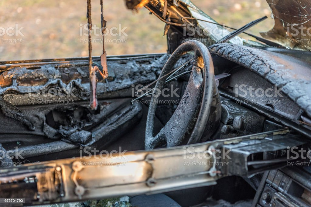 A few minutes in the street burnt car. Traffic is stopped. Firefighters eliminate fire. royalty-free stock photo