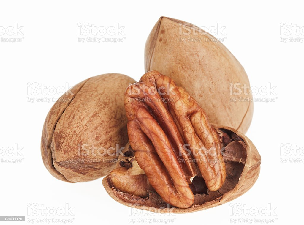 Few pecan nuts isolated on white, one cracked stock photo