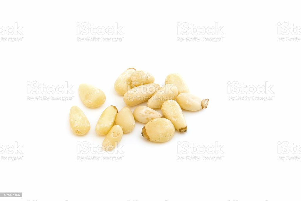 Few pine nuts on white stock photo