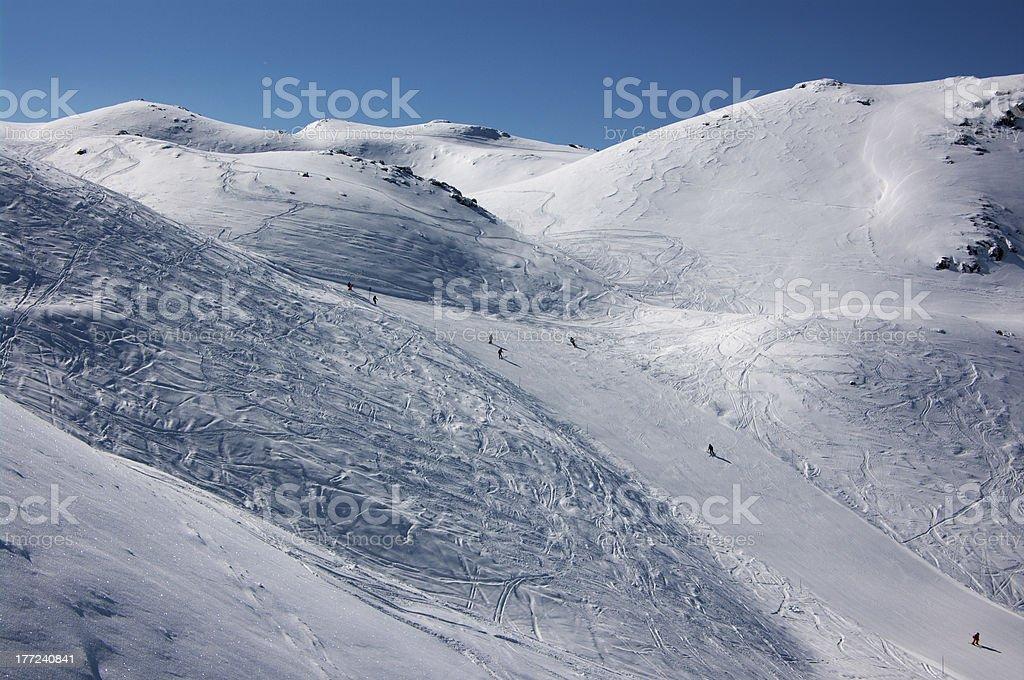 Few skiers on long ski slopes royalty-free stock photo