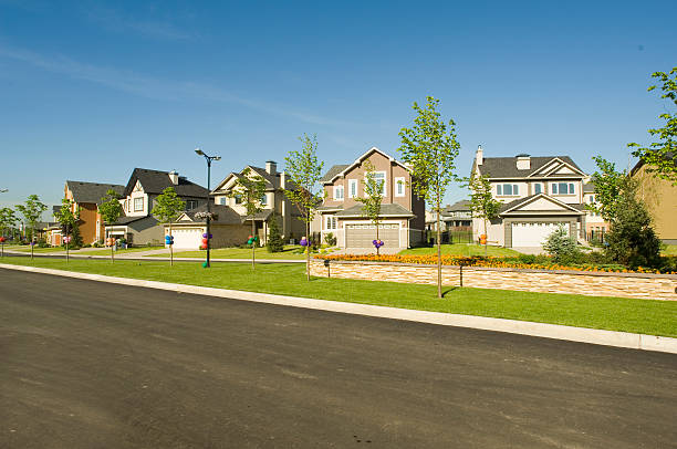 few suburban houses. - suburban street stock photos and pictures