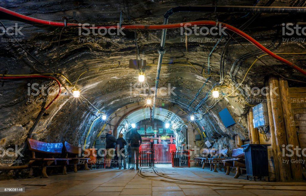 A few tourist waiting underground in the mine for the elevator stock photo