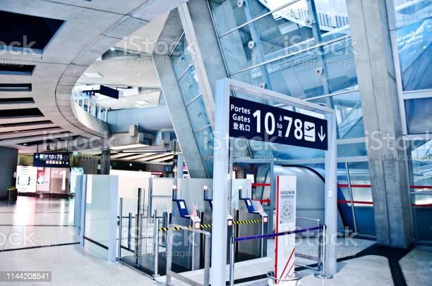 Few touristspassengers near gates 10 to 78 at paris charles de gaulle picture id1144208541?b=1&k=6&m=1144208541&s=612x612&h=r64bo nnymhwojkgbjlg20rrznf4xpwft8ub 4sueem=