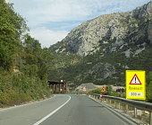 Traffic signs on the road under construction