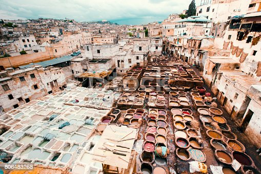 Fez cityscape from above with traditional leather tanning and dyeing tannery in the old medina of Fez - Fes, Morocco, Africa.