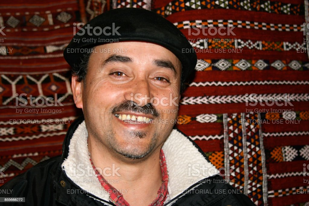Fez, Morocco: Grinning Carpet Seller in the Medina (Close-Up) stock photo