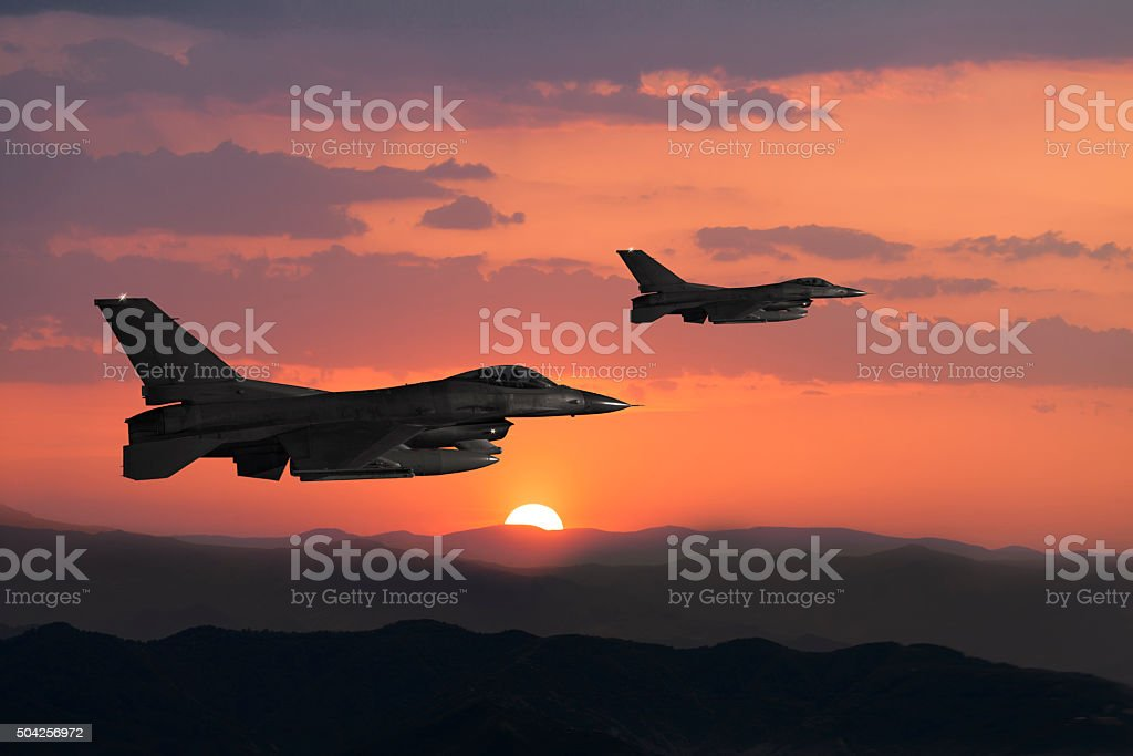 Fıghter Jet in flight at sunset stock photo