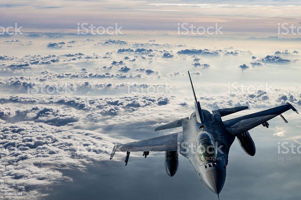 Fıghter Jet in flight Fıghter Jet flying over clouds. Advanced Tactical Fighter Stock Photo