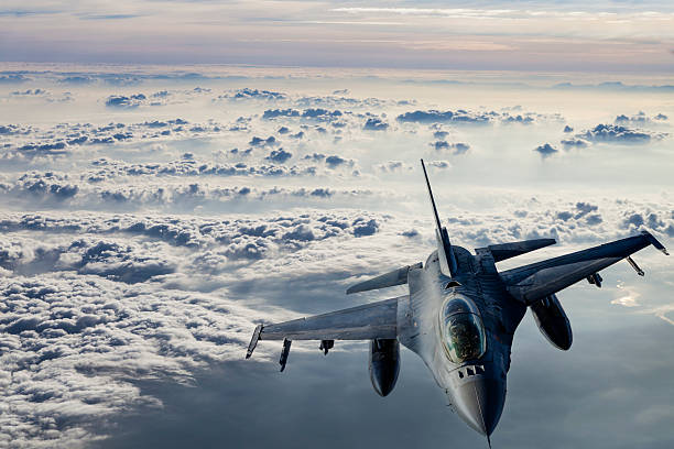 Fıghter Jet in flight Fıghter Jet flying over clouds. air force stock pictures, royalty-free photos & images