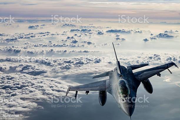 Fıghter Jet flying over clouds.