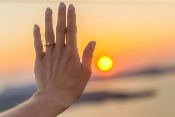 fiancé & sunset - diamond ring hand stock photos and pictures